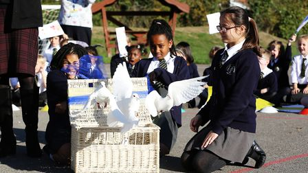 Year six children at Pope Paul Primary School release doves to mark the end of their celebration of