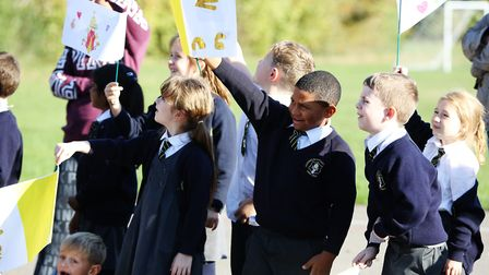 Children at Pope Paul Primary School release doves to mark the end of their celebration of Pope Paul