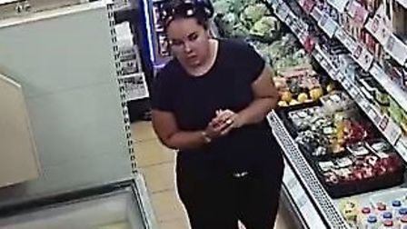 CCTV images of a woman Norfolk Police would like to speak to in connection to an attempted fraud in