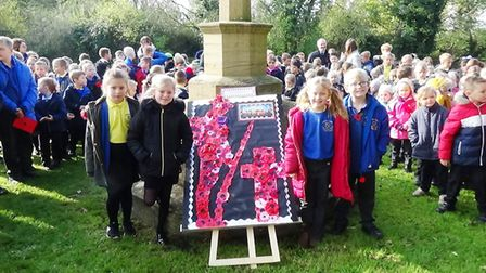 Children from Anthony Curton and Tilney All Saints Primary Schools remember the fallen. Picture: JAN