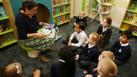 Local author Alice Hemming reads one of her books to members of St John's student council at the ope
