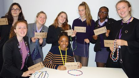 Former Maru-a-Pula student Thato Mauco with the Queenswood School girls who will be supporting Hope
