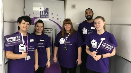 Staff at Hatfield Galleria on Purple Tuesday with the new toilet sign. Picture: supplied by Crohn's