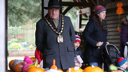 Chairman of North Herts district council John Bishop judges the pumpkin competition at the Knebworth