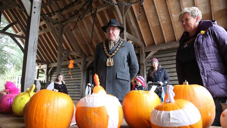 Chairman of North Herts district council John Bishop judges the pumpkin competition with Knebworth H