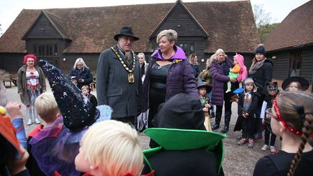 Chairman of North Herts district council John Bishop judges the Halloween costume competition with K