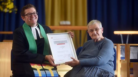 Adam Stevenson presenting a certificate to Janet Killingback for 50 years as a Methodist minister i