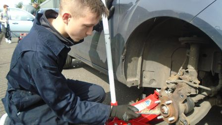 A Meadowgate School student carrying out work experience at the motor vehicle workshop
