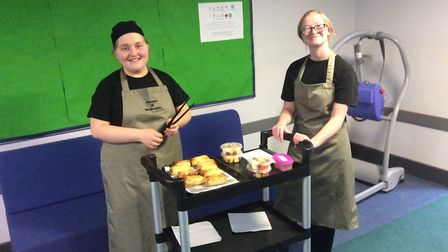 Meadowgate School studenst with the Bramley Cafe delivery trolley