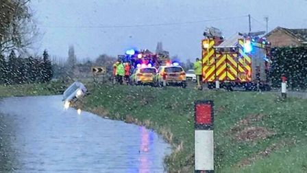 The A1122 was closed for a time after this car left the road and nearly ended up under water at Outw