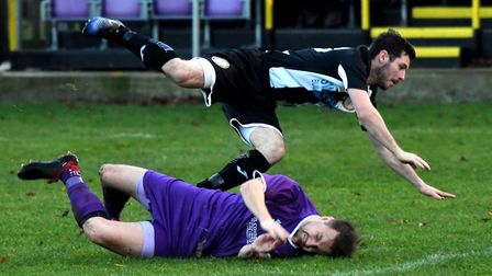 A Wisbech St Mary player slides in during their loss against Swaffham Town. Picture: IAN CARTER