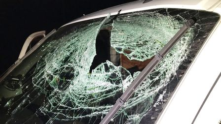 Pictures from the scene where a van driver's head was forced through the front window of the van the