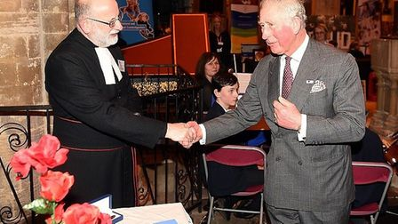 Canon Matthew Bradbury entertains Prince Charles at St Peter and St Paul Church, Wisbech. Picture: E