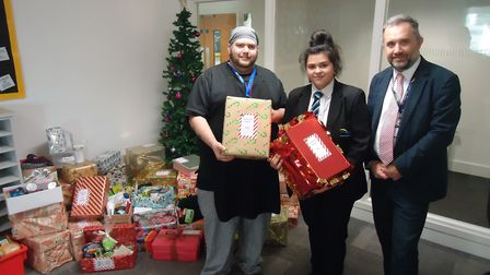 Left to right: George Ennis, assistant cook for the Ferry Project, Lusia Slavova, Year 8 student and