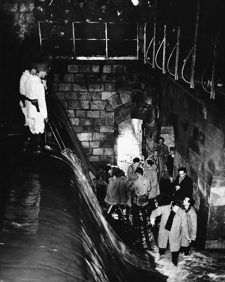 Crew members in a sewer in Vienna, Austria, during the filming of 'The Third Man', circa 1948. (Phot