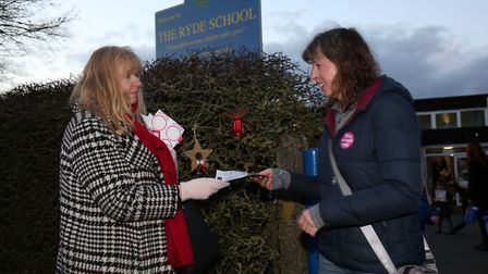 MP candidate Rosie Newbigging (left) hands out Stop The Education Cuts in Welwyn and Hatfield leafle