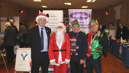 Golden Age Fair at Friday Bridge: from left, Cllr Will Sutton, Father Christmas (AKA Cllr Sam Clark)