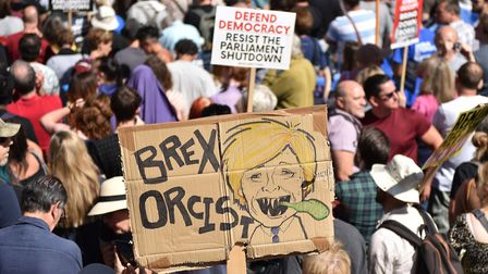 """A protester holds a placard of Boris Johnson with the words """"Brex Orcist"""". (Photo by John Keeble/Get"""