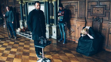 Director Yorgos Lanthimos on the set of The Favourite in the Long Gallery of Hatfield House, with Em