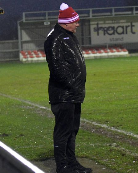 Drenched Wisbech Town boss Gary Setchell during his side's defeat to Carlton. Picture: IAN CARTER