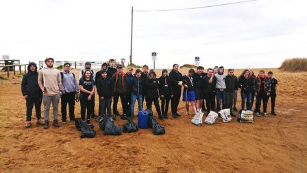 Students from the college's King's Lynn and Wisbech campuses braved the cold to clean two of Norfolk