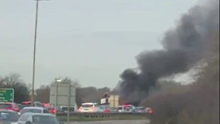 Smoke rises from the fire on the A414 near Cole Green. Picture: Supplied.