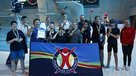 Knightsfield pupils and teachers celebrate after being crowned national deaf swimming champions. Pic