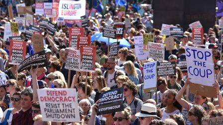 Protesters gather outside Downing Street for the Stop The Coup protests. (Photo by John Keeble/Getty