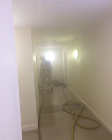 Firefighters from Welwyn Garden City, St Albans and Borehamwood put out a fire in a Hatfield flat. P