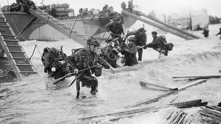 Commandos of HQ 4th Special Service Brigade coming ashore from LCI(S) landing craft on Nan Red beach