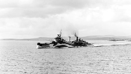 HMS Belfast leaving Scapa Flow for the Normandy beaches in June 1944. The ship is reported to have f