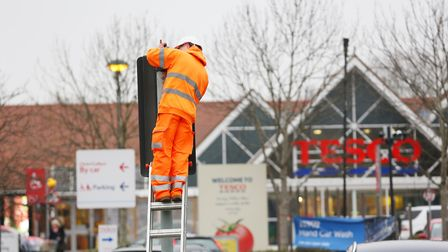 A Ringway engineer adjusts wiring for planned accessibility improvements at the lights outside Tesco