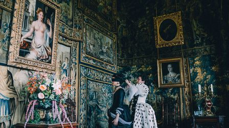 Olivia Colman as Queen Anne blindfolds Rachel Weisz, left, as Sarah Churchill, in The Favourite. Thi
