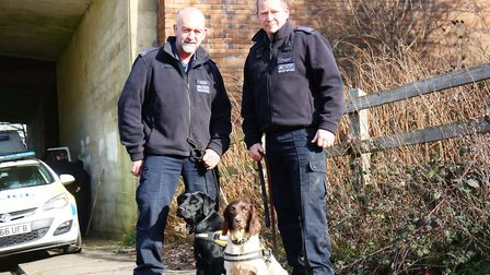 A police dog search team search an area of Norton Green for any sign of missing University of Hertfo