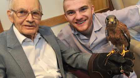 Raymond Uffen and Connor Jackman with a bird of prey at Care UK's Knebworth Care Home in Woolmer Gre