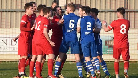 Wisbech Town and Pontefract Collieries players clash during a feisty fixture last Saturday. Picture:
