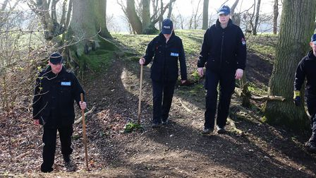 A police search team search an area of Norton Green for any sign of missing University of Hertfordsh