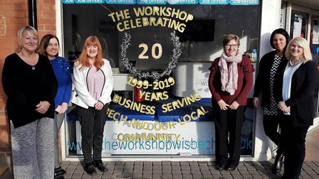 Ruth Whitehurst, managing director of The Workshop (pictured middle left), with her Wisbech team out