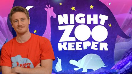 Buzz Burman of the Night Zoo Keeper visits children at Peckover Primary in Wisbech. He is about to l