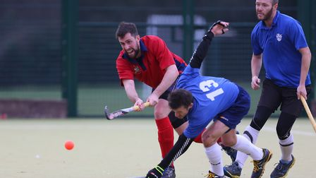 Laurie Brown lifts a pass past Mark Skilbeck in the match between Stevenage v WGC mens 1's. Picture: