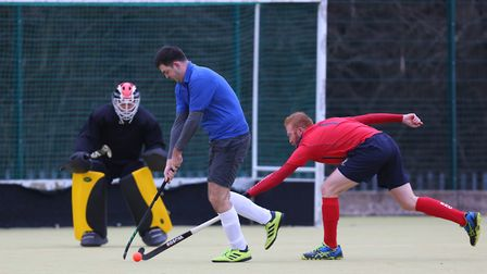 David Allmand-Smith fires in a backhanded shot as John Mould tries to block in the match between Ste
