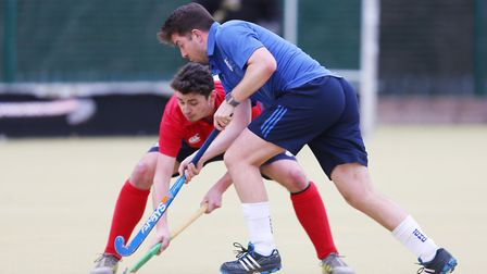 Dan Hatt is tackled by Andy Davies in the match between Stevenage v WGC mens 1's. Picture: DANNY LOO