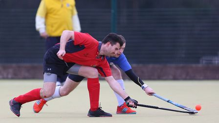 Andy Gardner challenges Bryn Evans in the match between Stevenage v WGC mens 1's. Picture: DANNY LOO