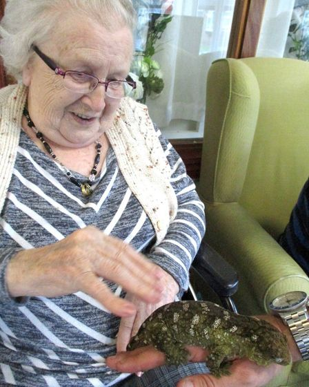 Hickathrift House resident Audrey Melton enjoys the exotic animals visit. Picture: HICKATHRIFT HOUSE