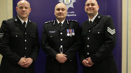 Sergeants Darren Gore and Carl Harris were commended for saving a woman who was threatening to drown