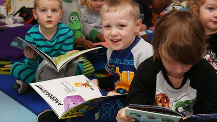 Reception's Brandon Loo, five, reads his favourite book at Holy Family Catholic Primary School who a