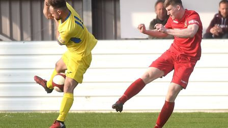 Harry Peasgood sees an effort blocked during Wisbech Town's draw with AFC Mansfield. Picture: IAN CA