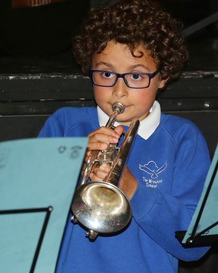 Several different primary schools in Potters Bar rehearsing a musical show at the Wyllyotts Theatre.