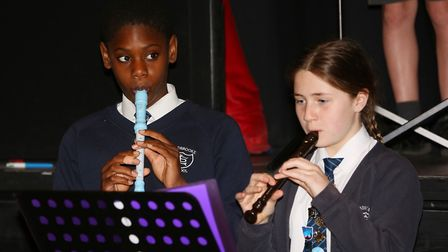 Pupils from several primary schools in Potters Bar rehearsing a musical show at the Wyllyotts Theatr