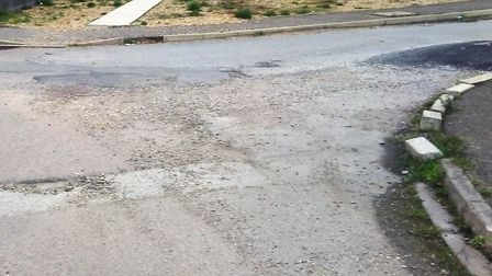 Gaping holes in 'death trap' roads in Wisbech have been filled in with gravel following an ongoing b